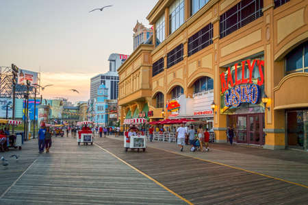 ATLANTIC CITY NEW JERSEY - SEPTEMBER 2: The boardwalk at sunset on September 2 2014 in Atlantic City New Jersey.