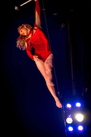 trapeze: OLD BRIDGE, NEW JERSEY -JUNE 8 - Rebecca Ostroff a trapeze artist hanging from the bar at the Kelly Miller Circus on June 8 2015 in Old Bridge New Jersey. Editorial