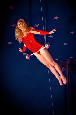 kelly: OLD BRIDGE, NEW JERSEY -JUNE 8 - Kimberly Souren a trapeze artist hanging from the bar at the Kelly Miller Circus on June 8 2015 in Old Bridge New Jersey. Editorial
