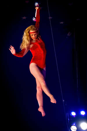 trapeze: OLD BRIDGE, NEW JERSEY -JUNE 8 - Kimberly Souren a trapeze artist hanging from the bar at the Kelly Miller Circus on June 8 2015 in Old Bridge New Jersey. Editorial