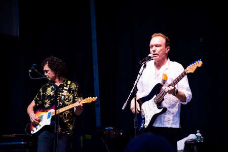 pop idol: MANALAPAN, NEW JERSEY -JUNE 20 - David Cassidy and lead guitarist Dave Robicheau in concert on June 20 2015 in Manalapan New Jersey.