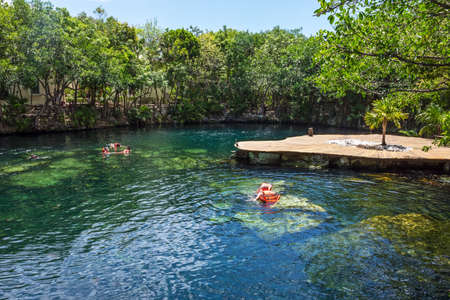 PLAYA DEL CARMEN,MEXICO-MAY 23- Tourists swimming in a cenote at a resort on May 23 2015 in Playa del Carmen in Mexico.
