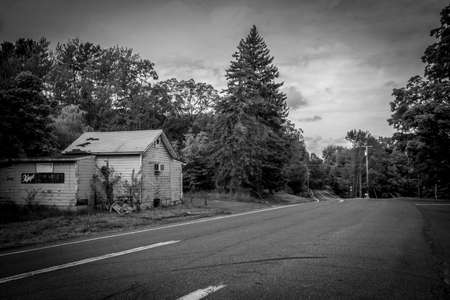 country store: GARDINER, NEW YORK -SEPTEMBER 28 - An old country road with an abandoned roadside store on September 28 2015 near Gardiner NY.