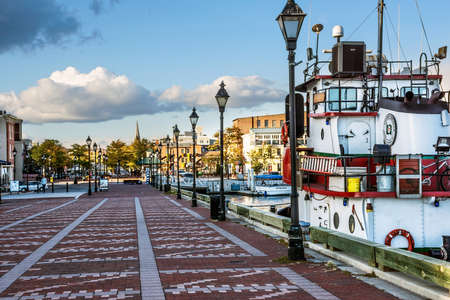 fells: BALTIMORE-OCTOBER 18: A view of a pier with a tug boat in Fells Point, a popular tourist destination on October 18 2015 in Baltimore.