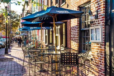 fells: BALTIMORE-OCTOBER 18: Sidewalk dining and quaint shops at Fells Point, a popular tourist destination on October 18 2015 in Baltimore.