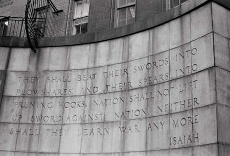 testament: A black and white film photograph of a famous Old Testament Bible quote on an East Side wall in Manhattan. Stock Photo