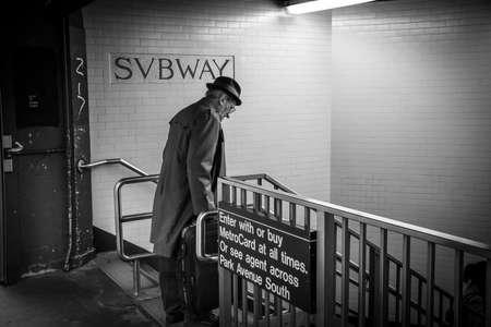 enters: NEW YORK-OCTOBER 23 - An old man enters a subway station on October 23, 2015 in Mid-town Manhattan.