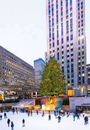 New York, NY, USA - December 7, 2015: The world famous Rockefeller Christmas tree and ice skating rink in New York City.