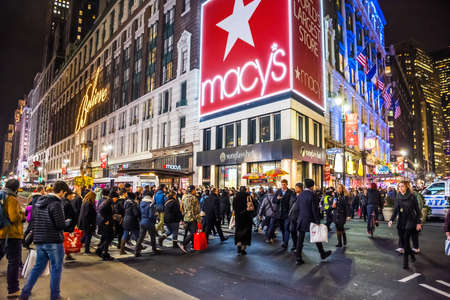 macys: NEW YORK-DECEMBER 21: A large crowd of shoppers and tourists in Herald Square near Macys on December 21 2015 in New York City.