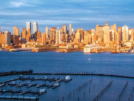 hudson river: A view of a marina on the Hudson River with the New York City skyline at twilight.