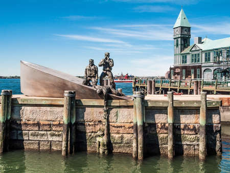 The Merchant Mariners Memorial depicting a World War 2 scene on display in Battery Park in lower Manhattan. Imagens
