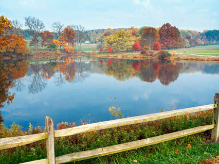 fall trees: An Autumn view of the pond in Holmdel Park in Monmouth County New Jersey. Stock Photo
