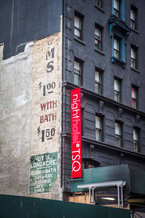 adverts: NEW YORK-FEBRUARY 5 - An old ad from the historic Hotel Longacre from about 1910 was exposed after taking down adjoining building on 47th St. Photo taken on February 5, 2016 in New York City.