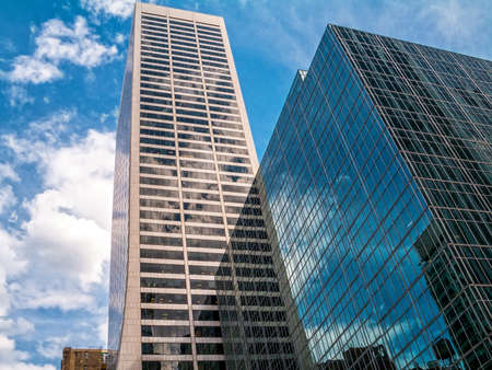 Steel and glass skyscrapers reflecting the sky in Manhattan. Stock Photo