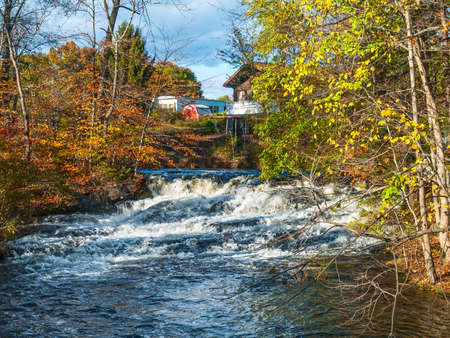 A fast moving stream with a small waterfall during Autumn in the Pocono Mountains of Pennsylvania. Stock Photo