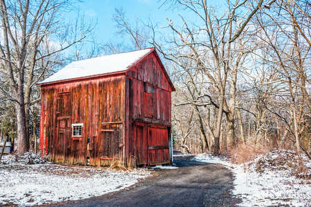 old barn in winter: An old red wooden barn in rural Central New Jersey.