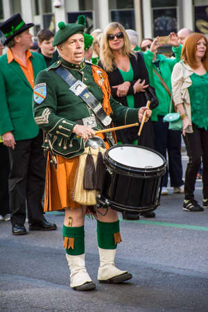ave: New York, NY, USA - March 17, 2016: A drummer dressed in a kilt marches in the St Patrick�s Day Parade on on 5th Ave in New York City.