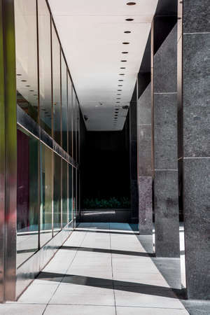 architecture abstract: Sunlight streams through this contemporary building walkway in New York City. Stock Photo
