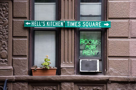 rentals: An apartment building with a neon sign in the window for room rentals in Manhattan. Stock Photo