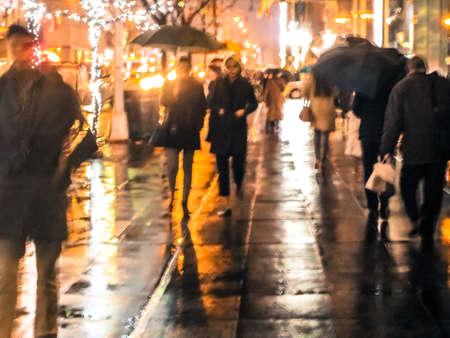 An abstract blur of a rainy New York City street scene.