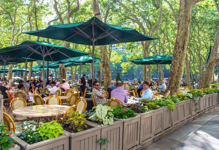 outdoor dining: NEW YORK-JUNE 9: Outdoor dining in Bryant Park on June 9 2015 in New York City.