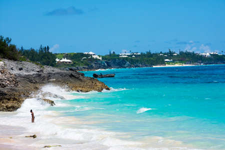 bermuda: Turquoise colored water and white roofed homes off in the distance of this Bermuda seascape.