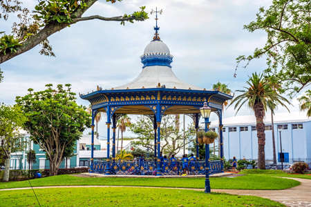 victoria park: HAMILTON,BERMUDA, MAY 25 - Children play wearing school uniforms by the old gazebo in Victoria Park on May 25 2016 in Hamilton,Bermuda.
