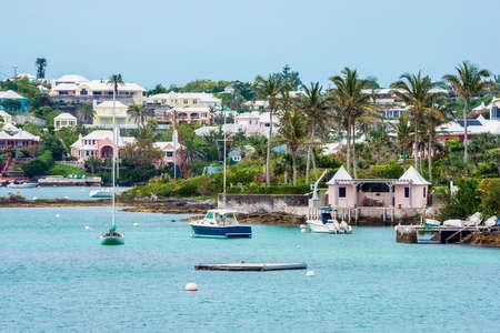 Boats and colorful architecture along the shoreline in Hamilton Bermuda. Stock Photo
