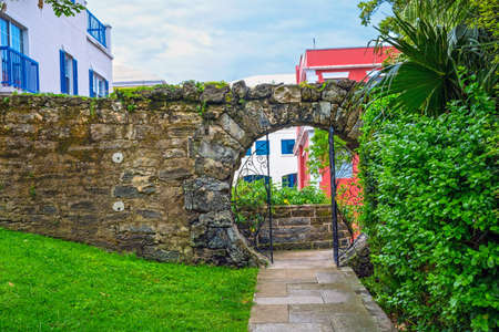 moon gate: An old stone wall with a moon gate in Queens Park, Hamilton Bermuda. Stock Photo