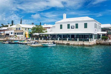 outdoor dining: ST.GEORGES, BERMUDA, MAY 27 - Turquoise colored water surrounds this restaurant with outdoor dining on May 27 2016 in St. George�s Bermuda. Editorial
