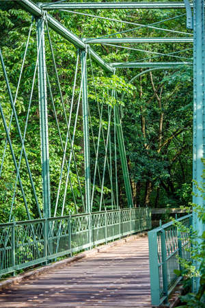 county somerset: The Hibernia Mine Railroad Bridge dates back to 1879 but was reassembled as a foot bridge for the Raritan Greenway Park in 2007. Stock Photo