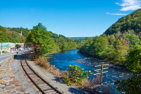 JIM THORPE, PENNSYLVANIA, - SEPTEMBER 28: Railroad tracks along the Lehigh River lead into Scenic Jim Thorpe on September 28 2016 in Pennsylvania Editorial