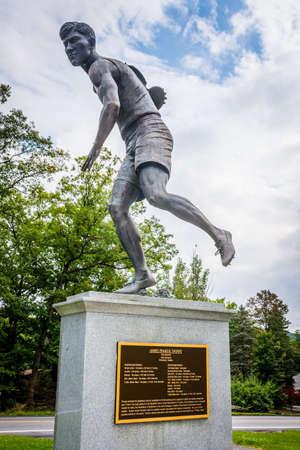 discus: JIM THORPE, PENNSYLVANIA, - SEPTEMBER 28: The Jim Thorpe discus monument in his Memorial Park on September 28 2016 in Jim Thorpe Pennsylvania.