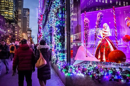 NEW YORK-DECEMBER 7: Tourists and New Yorkers admire the holiday decorations and lights on Fifth Avenue on December 7 2016 in New York City. Editorial