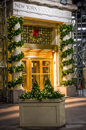 NEW YORK-DECEMBER 05: Christmas decorations and lights adorn the entrance to the New York Stock Exchange on December 5, 2017 in lower Manhattan.