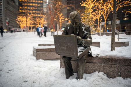 NEW YORK-JANUARY 4: The businessman statue with fresh snow after the bomb cyclone snow storm in Zuccotti Park on January 4 2018 in lower Manhattan. Redakční