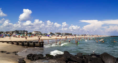 BELMAR, NEW JERSEY-AUGUST 20, 2016: A panoramic crowded beach view on a hot Summer day on August 20 2016 in Belmar New Jersey. Editöryel