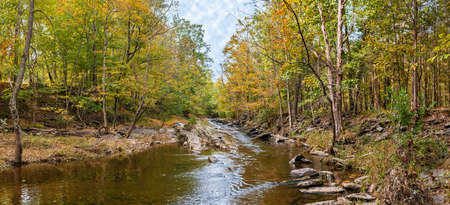 A panoramic Fall view of Tohickon Creek in Bucks County Pennsylvania.
