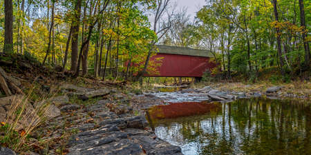 The Cabin Run Covered Bridge spans Tohickon Creek in Bucks County Pennsylvania.
