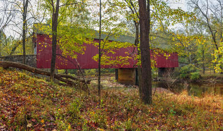 A panoramic view of the Frankenfield Covered Bridge which spans the Tinicum Creek in Bucks County Pennsylvania.