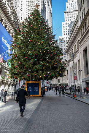 NEW YORK-DECEMBER 4: The Christmas tree on Wall St during lunch hour on December 4 2018 in New York City. Editorial