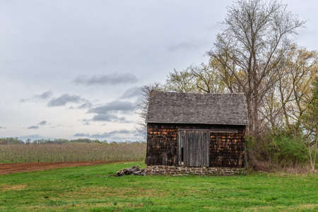 A historic barn with stone foundation in Monmouth Battlefield State Park in New Jersey.