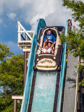 JACKSON, NEW JERSEY - JUNE 30: A Family enjoys a log flume ride at Six Flags Great Adventure on June 30 2007 in Jackson New Jersey.