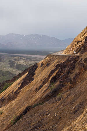 Steep mountain roads of Denali National Park, most only open to tour busses and park rangers. Stock Photo