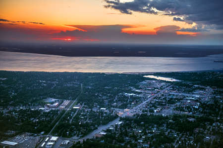 An aerial sunset view ofer Anchorage Alaska with the Turnagain Arm which leads to the Gulf of Alaska.