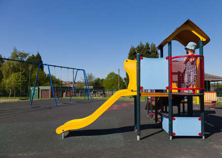 Child on playground slide photo