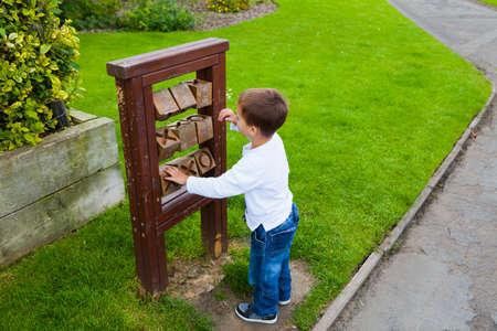 Child turning blocks photo