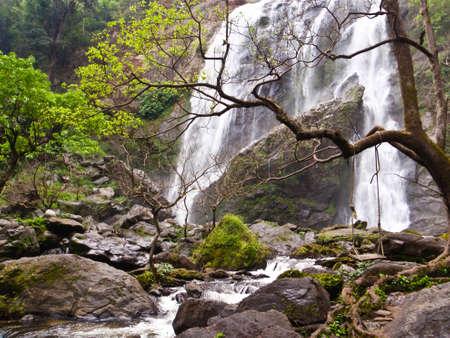 Swing in Waterfall at Kamphaeng Phet Thailand Stock Photo