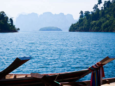 Wooden boat in Ratchaprapa Dam,Khao Sok,Thailand Stock Photo