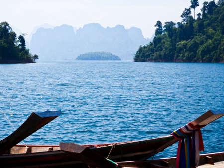 Wooden boat in Ratchaprapa Dam,Khao Sok,Thailand Stock Photo